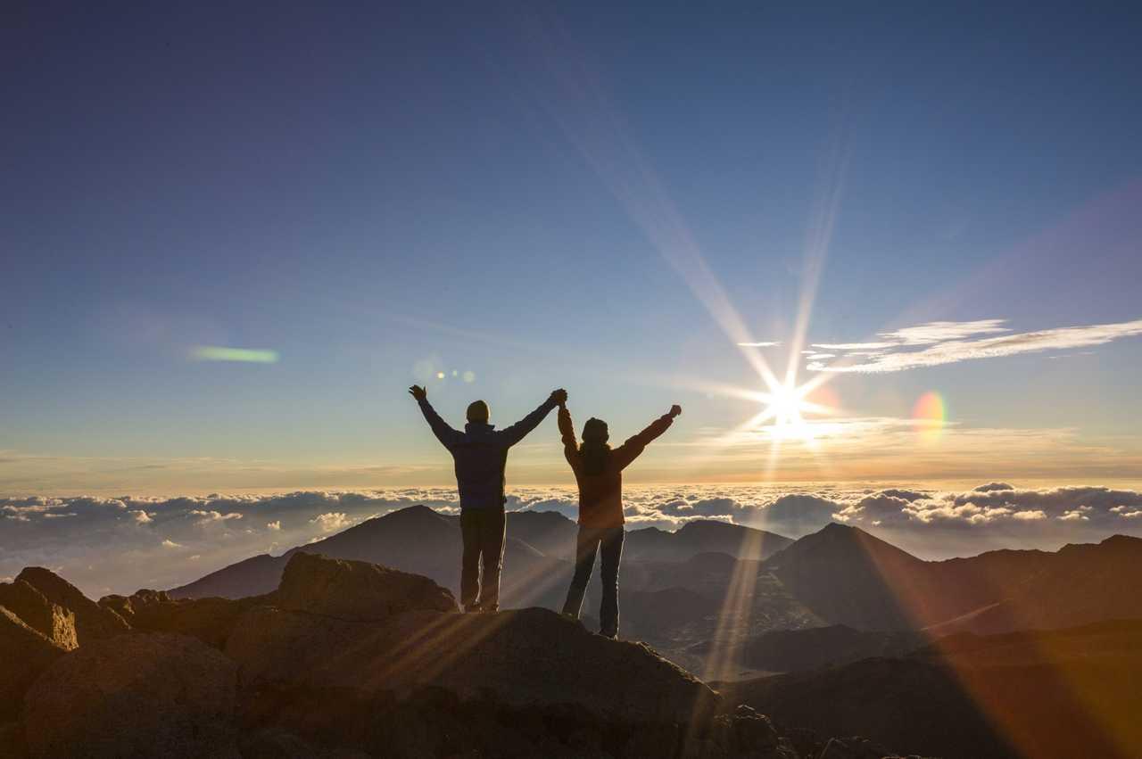 Couple enjoy the morning sun on Haleakala
