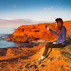 Handyfoto am roten Strand von Prince Edward Island
