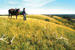 Reiter in der Prärie Manitobas