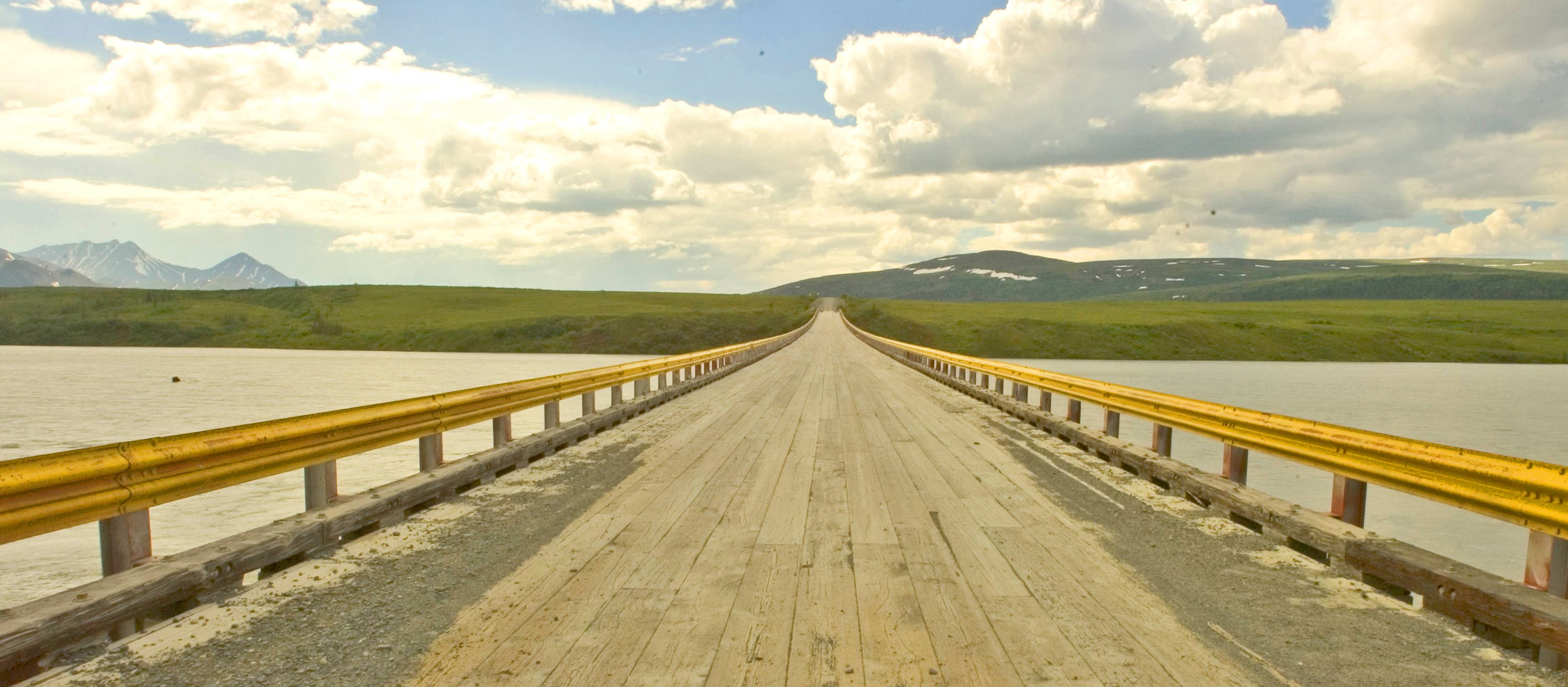 Matt Hage photo- Bridge over the Susitna River on the Denali Highway, Alaska.[#Beginning of Shooting Data Section] Nikon D100 Focal Length: 14mm White Balance: Auto Color Mode: Mode III (sRGB) 2005/01/29 11:29:00.7 Exposure Mode: Aperture Priority AF Mode: AF-S Hue Adjustment: 0¡ RAW (12-bit) Metering Mode: Multi-Pattern Tone Comp: Normal Sharpening: Normal Image Size: Large (3008 x 2000) 1/160 sec - f/5.6 Flash Sync Mode: Not Attached Noise Reduction: OFF Exposure Comp.: +1.7 EV Lens: 14mm f/2.8 D Sensitivity: ISO 400 Image Comment: [#End of Shooting Data Section]
