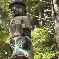 Totems in the Sitka National Historical Park in Sitka, Alaska. Trails wander through the park past a dozen restored totems.