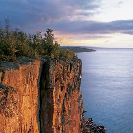 50. Sunrise over Lake Superior as viewed from Palisade Head near Tettegouche State Park. At a look out point 200 feet above Lake Superior, it would be hard to find a prettier sunrise. While youÕre up there youÕll probably see a wide display of colorful birds, with over 140 varieties of birds species calling Tettegouche State Park home. This park has it all, rivers, lakes, waterfalls, a Lake Superior shoreline, rugged hikes, camping sites, and secluded picnic sites near the visitor center. For the adventure seeker, there is a kayak-in campsite on Lake Superior.